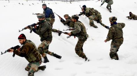 Army soldiers in action during a gunfight at Sopore  Photo Express